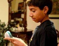 Vasanth inspects his solar light